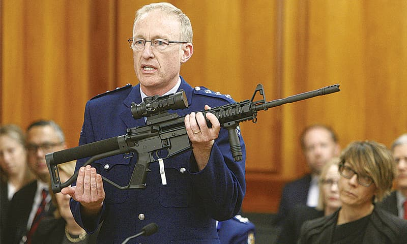 WELLINGTON (New Zealand): Police acting superintendent Mike McIlraith shows lawmakers an AR-15 style rifle similar to a weapon Brenton Tarrant had used to slaughter 50 people in two mosques.—AP
