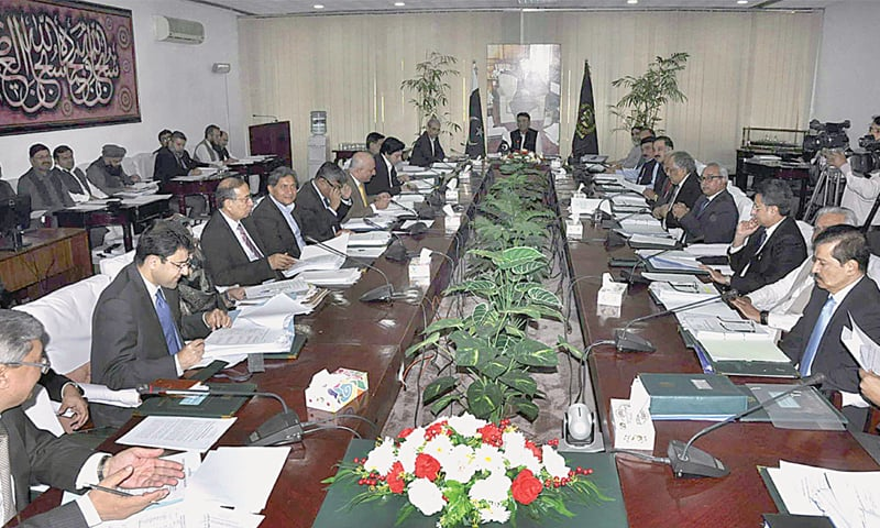 ISLAMABAD: Federal Minister for Finance, Revenue and Economic Affairs Asad Umar chairs a meeting of the Economic Coordination Committee on Wednesday.—APP
