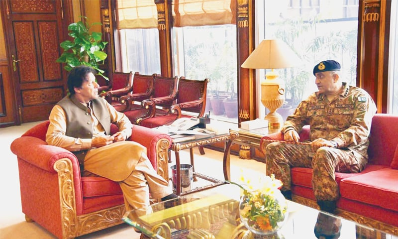 ISLAMABAD: Prime Minister Imran Khan speaks to Chief of the Army Staff Gen Qamar Javed Bajwa during their meeting at PM Office on Thursday.—PPI