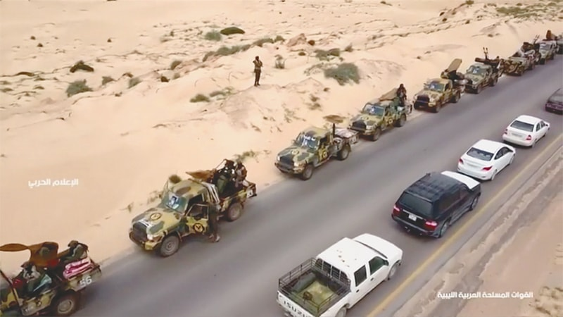 An aerial view shows military vehicles on a road in Libya on Thursday.—Reuters