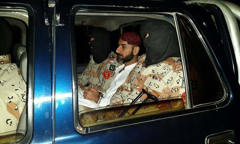 The file photo shows Uzair Baloch in the custody of Sindh Rangers.— Photo courtesy of PRO