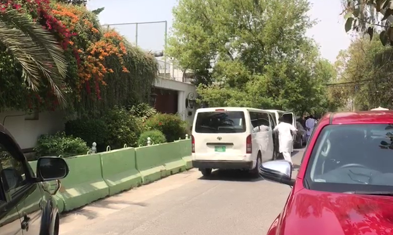 Vehicles are seen parked outside 96-H Model Town. — DawnNewsTV