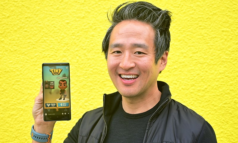 Bernard Kim, President of publishing at game developer Zynga, displays the game 'Tiny Royale' on his cellphone at the first annual Snap Partner Summit in West Hollywood, California on April 4, 2019. — AFP