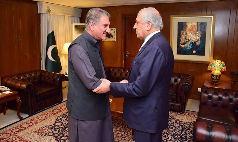 Foreign Minister Shah Mehmood Qureshi receives US envoy Zalmay Khalilzad at the Foreign Ministry on Friday.—AP