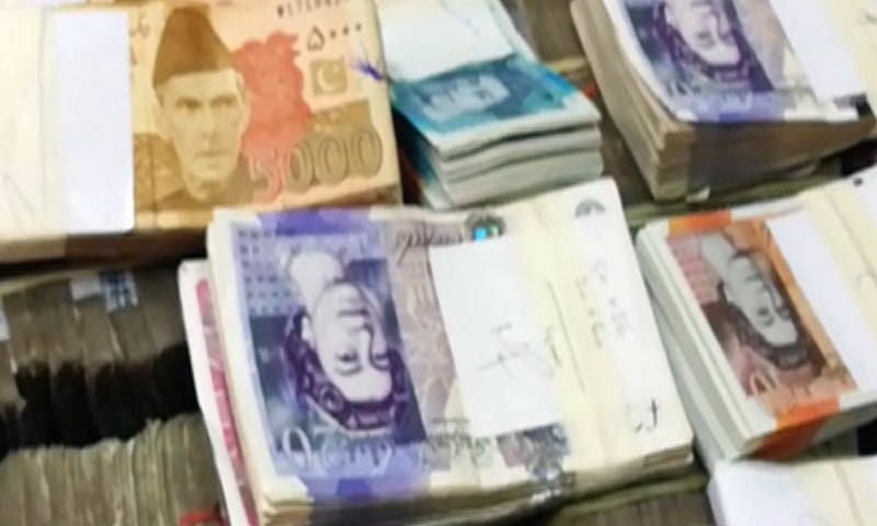 Foreign and local currency seized by FIA is seen. — DawnNewsTV