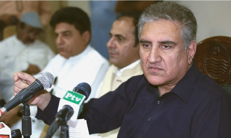 MULTAN: Foreign Minister Shah Mehmood Qureshi addresses a press conference  on Sunday.—AFP