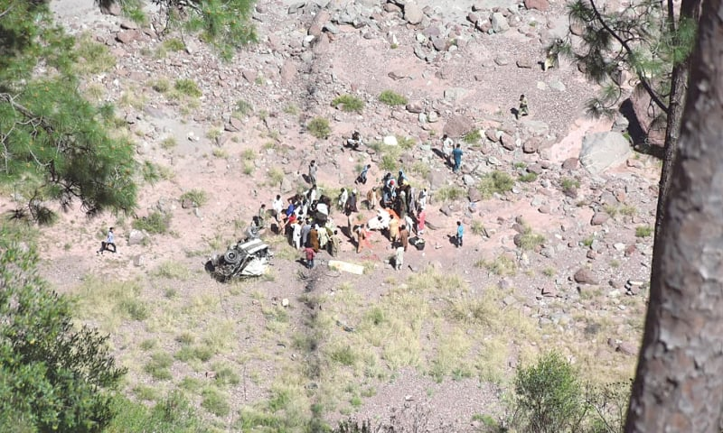 PEOPLE of the area look for remains of the accident victims. — Dawn