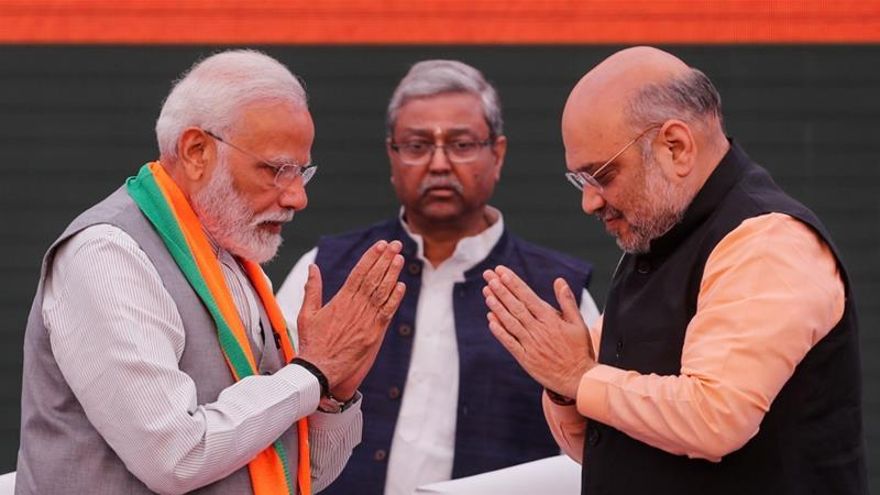 Indian Prime Minister Narendra Modi and chief of India's ruling Bharatiya Janata Party (BJP) Amit Shah, greet each other before releasing their party's election manifesto on Wednesday. ─ Reuters