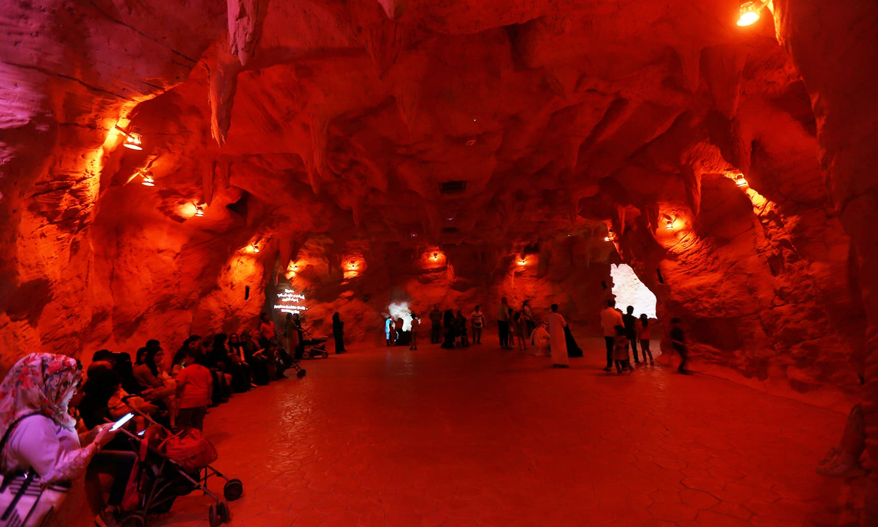 More visitors are pictured taking a tour of the Cave of Miracles. — Reuters