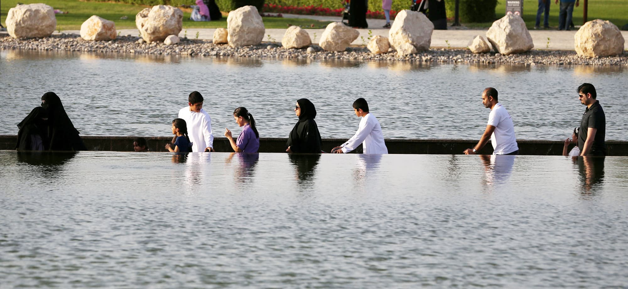 Visitors are seen crossing the lake at Dubai's Quranic Park in Dubai, UAE April 6, 2019. Picture taken April 6, 2019. REUTERS/Satish Kumar