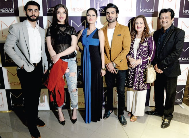 Actress Laila Zuberi and model Natasha Hussain pose with the Sherdil team at the launch of Meraki restaurant branch on Tuesday. — White Star