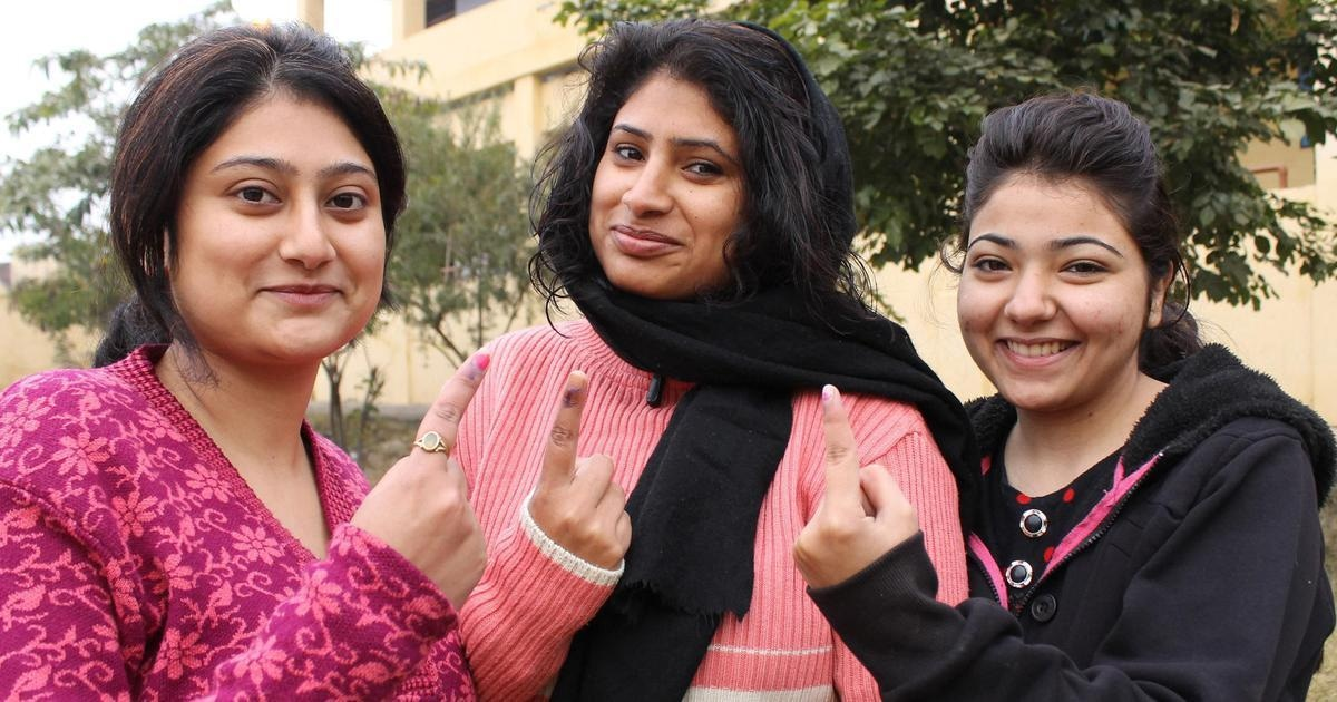 Jammu women after casting their votes during the fifth phase of Jammu and Kashmir Polls in Jammu, on December 20, 2014. | IANS