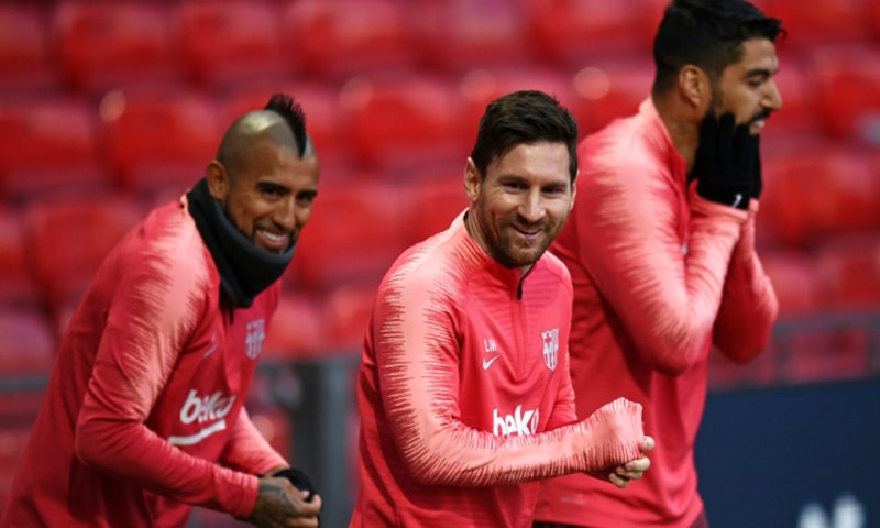Lionel Messi (centre) trains with his Barcelona teammates at Old Trafford. — AFP