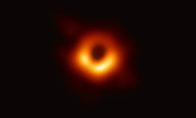 A handout photo provided by the European Southern Observatory on April 10, 2019 shows the first photograph of a black hole and its fiery halo. ─ AFP