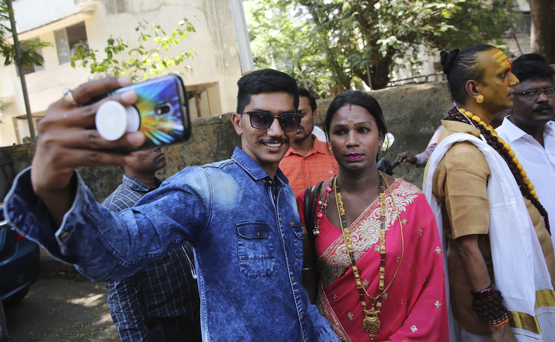A man takes selfie with Sneha Kale, a transgender person and, an Independent candidate for the upcoming election in Mumbai. — Reuters