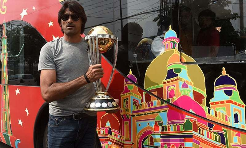 Towering pacer Mohammad Irfan poses with the World Cup trophy in a photo taken in October 2018. ─ AFP/File