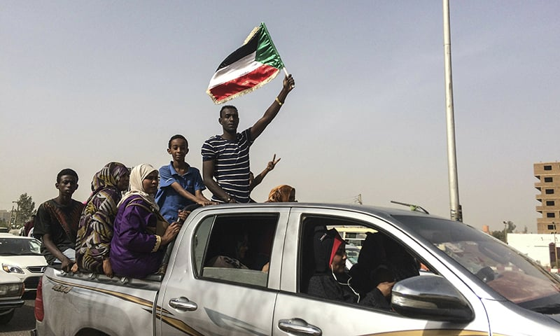 Protesters celebrate in Khartoum, Sudan, after the military forced longtime autocratic President Omar al-Bashir to step down after 30 years in power. ─ AP