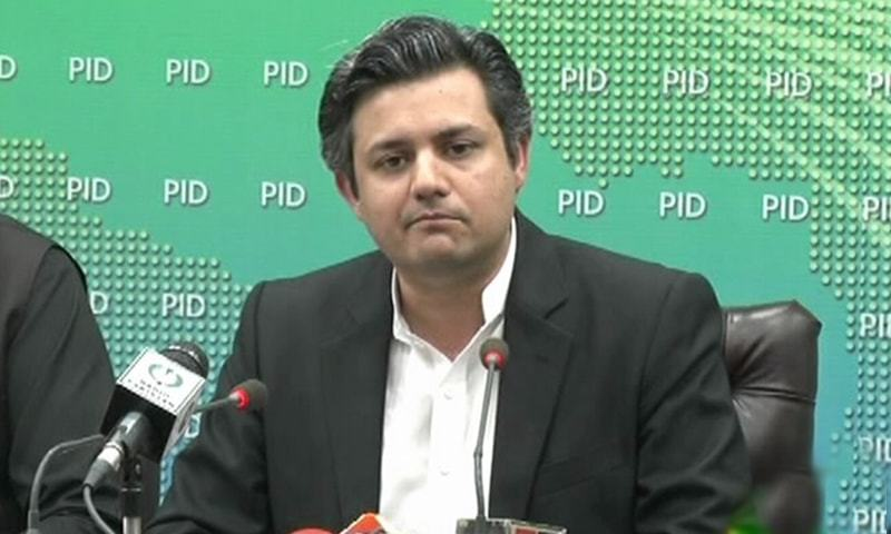 Minister for Revenue Hammad Azhar addressing a press conference in Islamabad on Thursday. — DawnNewsTV