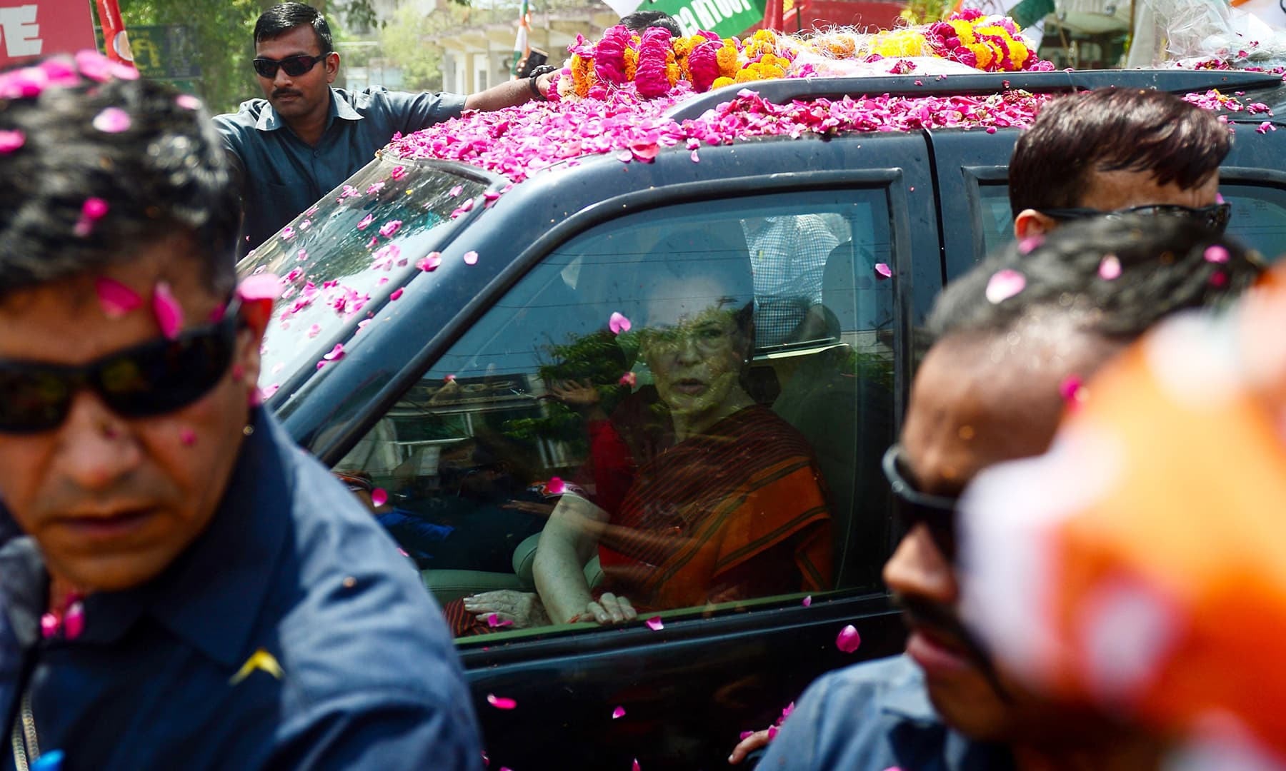 Indian Congress party senior leader Sonia Gandhi arrives in a car before filing her nomination papers for the forthcoming general election at a district court in Rae Bareilly on April 11, 2019. — AFP