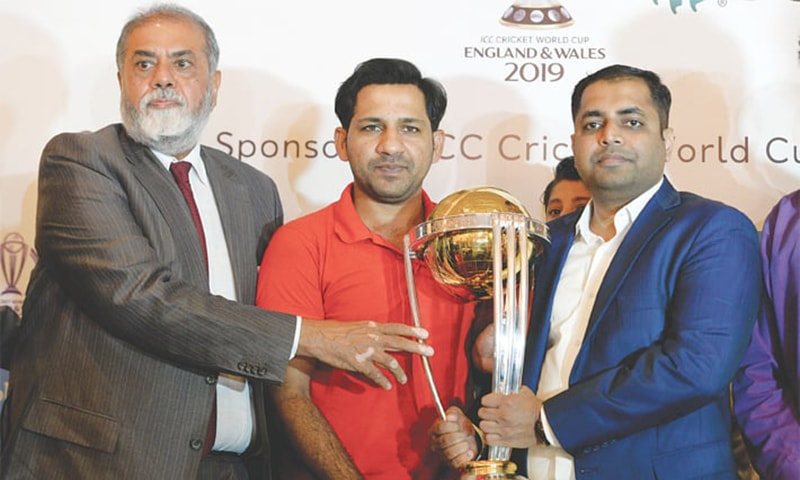 ISLAMABAD: Pakistan captain Sarfraz Ahmed poses with ICC World Trophy during it's Trophy Tour on Thursday.—Tanveer Shehzad/White Star