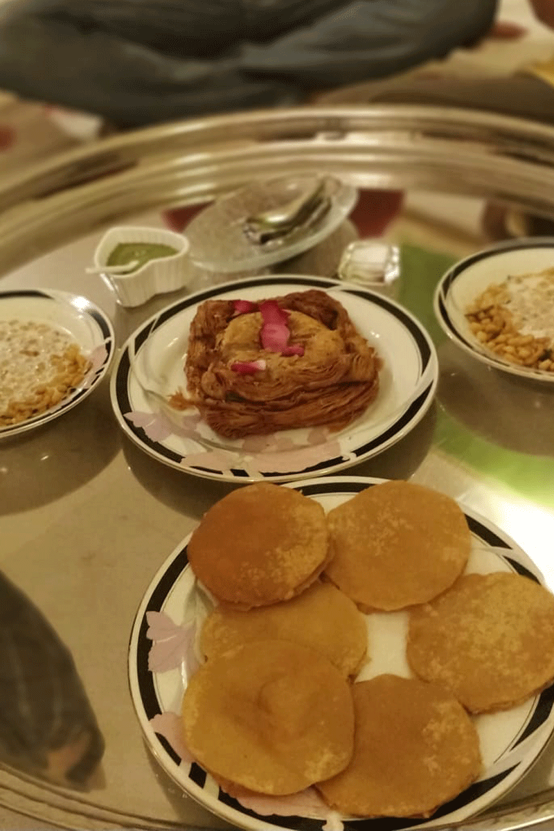 Top right: Kachori Papar, Top left: Boondi Raita. Centre: Malai Khaja.