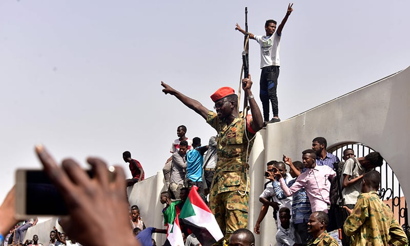 Members of the Sudanese military gather in a street in central Khartoum on April 11, 2019, after one of Africa's longest-serving presidents was toppled by the army. — AFP