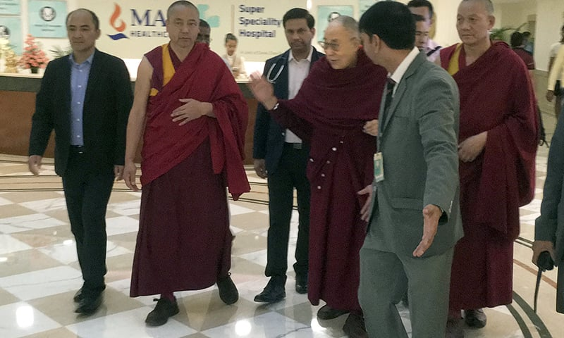 Tibetan spiritual leader the Dalai Lama, center, leaves from a hospital, in New Delhi, India, Friday, April 12. — AP