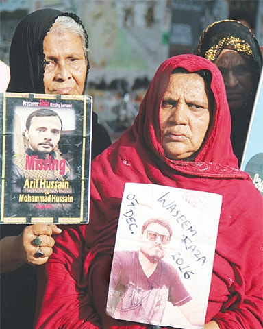RELATIVES of missing persons hold a demonstration outside the press club on Friday. The protesters also condemned the Quetta Hazarganji attack earlier in the day.—Online