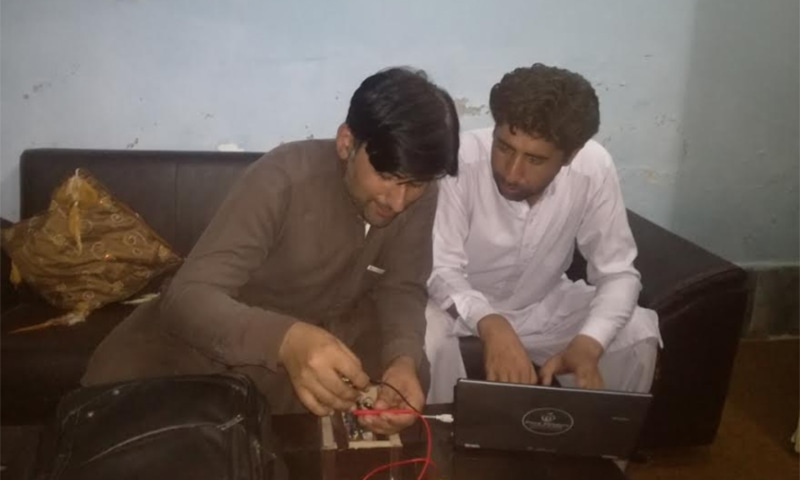 The two students work on the device. — Photo provided by author
