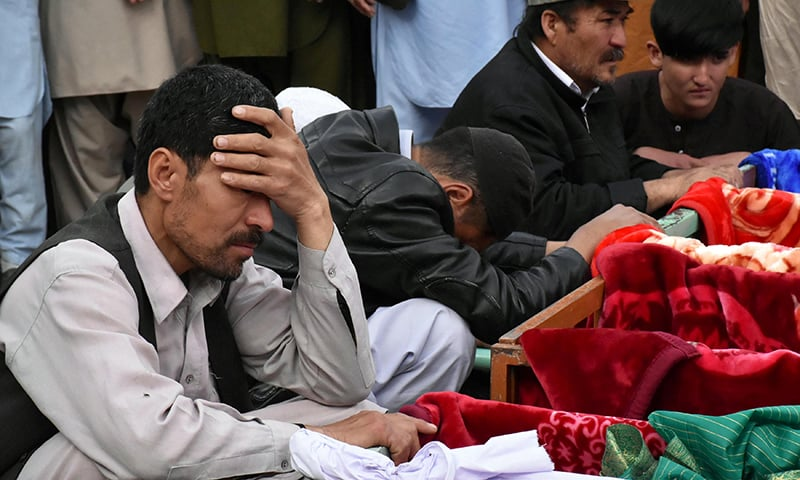 Family members mourn the death of their relatives, as they attend a funeral for the victims of the blast, April 12. — Reuters