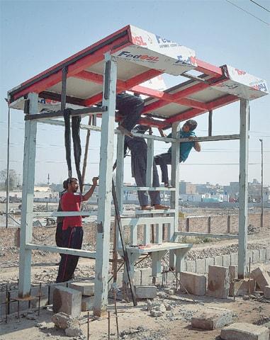Work underway at a bus stop on a BRT feeder road | Abdul Majeed Goraya/White Star