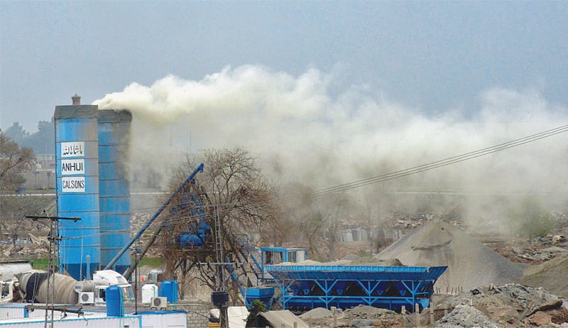A thick cloud of smoke rises from a BRT concrete-mixing plant in Chamkani. Environmental degradation as a result of the BRT is an ongoing crisis in Peshawar | Abdul Majeed Goraya/White Star