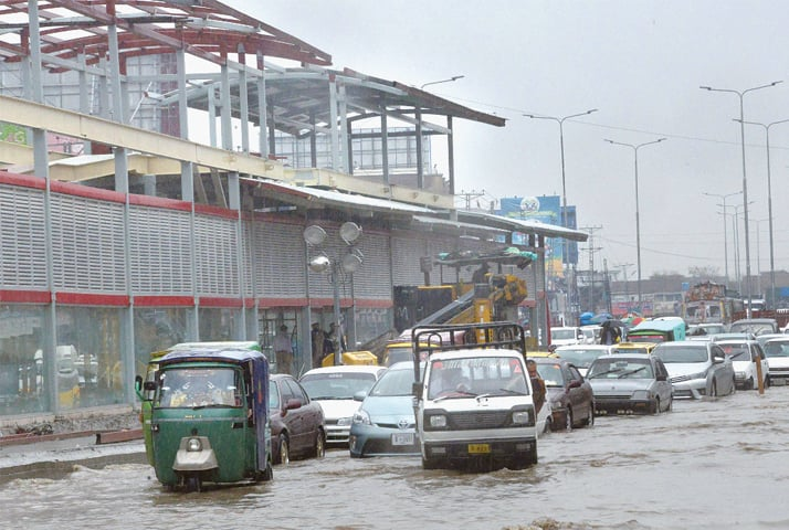 Such has been the design catastrophe in Peshawar due to the BRT project that even well-maintained roads are now being affected. This is near the BRT station on University Road, where vehicles are forced to pass through rainwater that has accumulated | Abdul Majeed Goraya/White Star