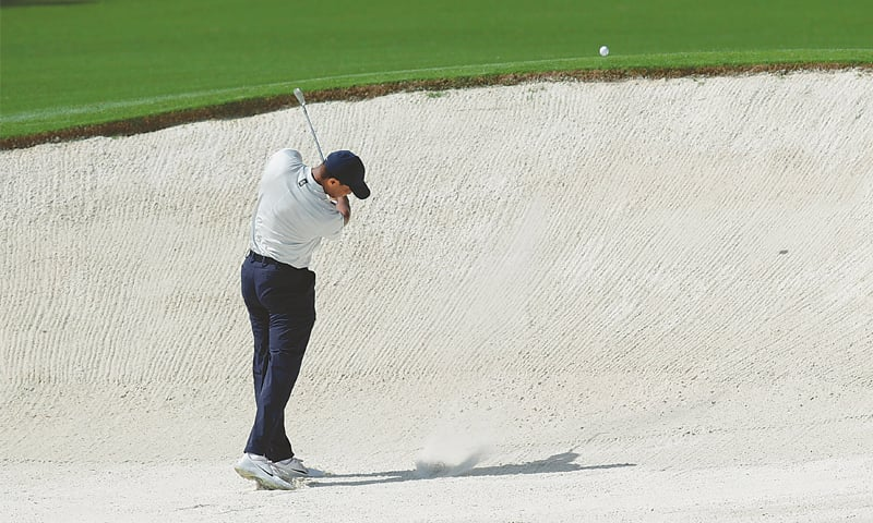 Tiger roars back to stay in contention at Augusta ...