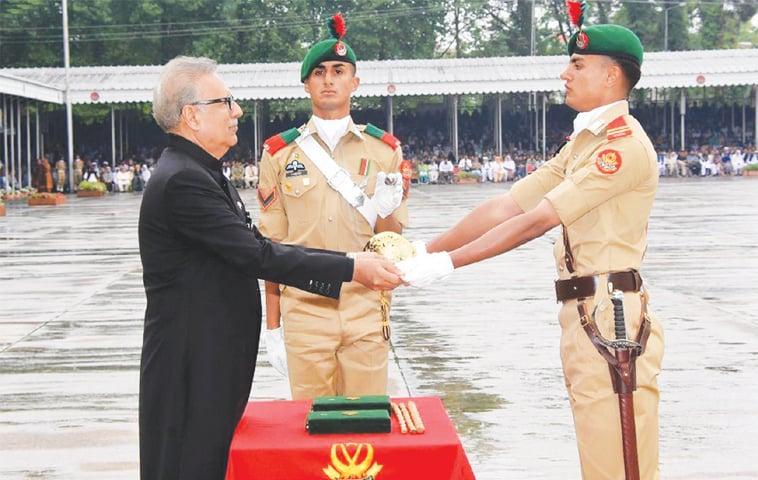 President Dr Arif Alvi awarding coveted sword of honour to senior under officer Haider Ali Khan at the Pakistan Military Academy, Kakul, on Saturday.—INP