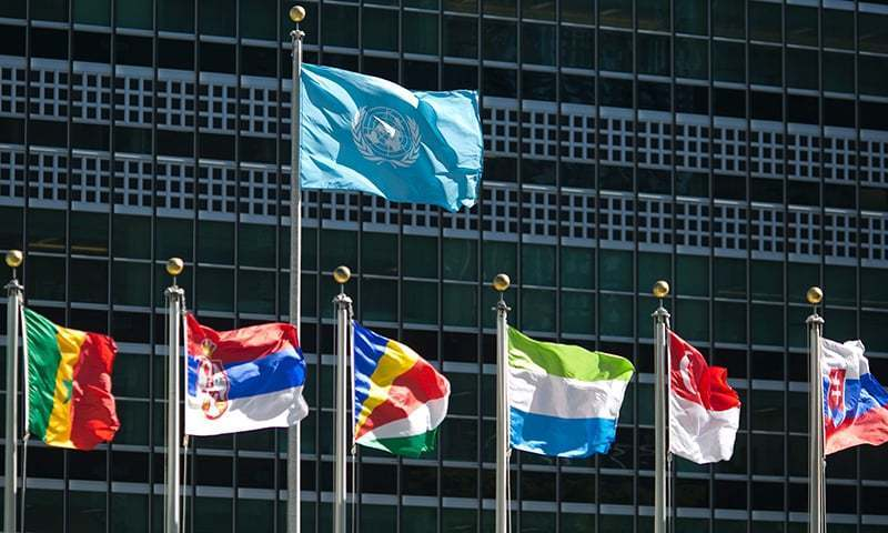 International flags fly in front of the United Nation's headquarters. — AFP