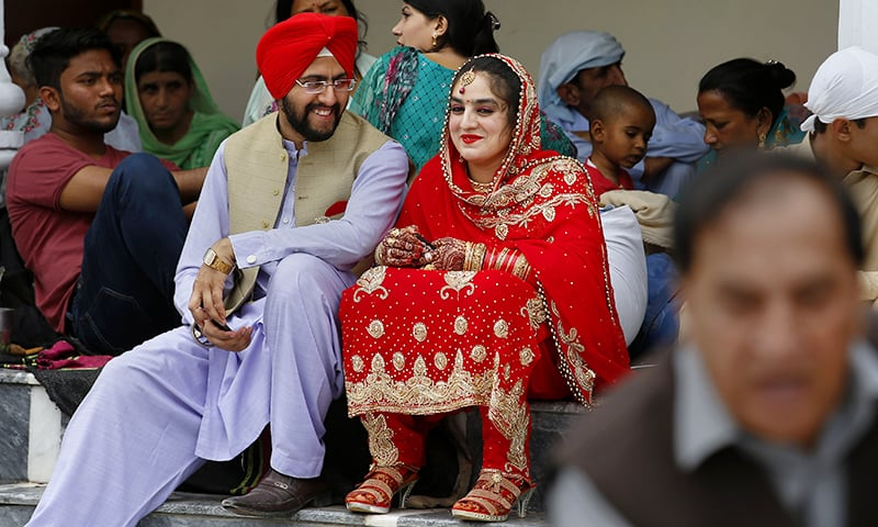 A newlywed Sikh couple attends the Vasakhi festival, at the shrine of Gurdwara Punja Sahib, the second most sacred place for Sikhs, in Hasan Abdal, some 50 kilometres from Islamabad, Sunday, April 14. — AP