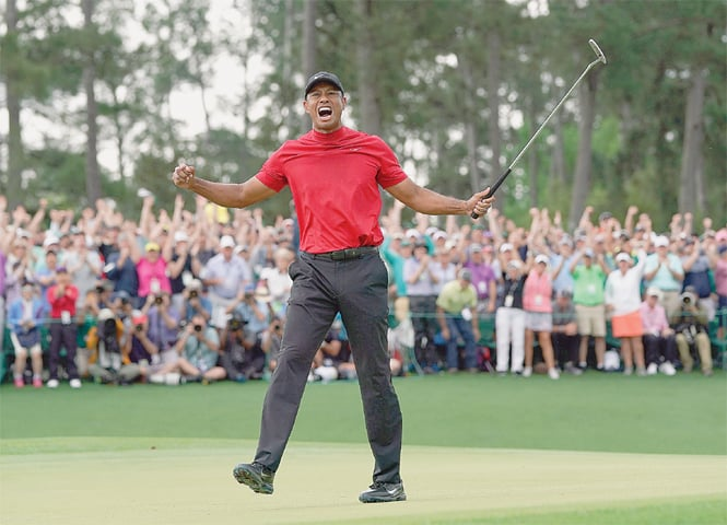 TIGER Woods is jubilant after winning the Masters golf tournament.—AP