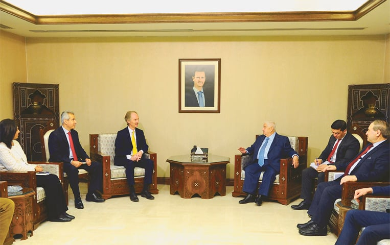 Syria's Deputy Prime Minister Walid Muallem meets United Nations Special Envoy Geir Pedersen in Damascus. — AFP