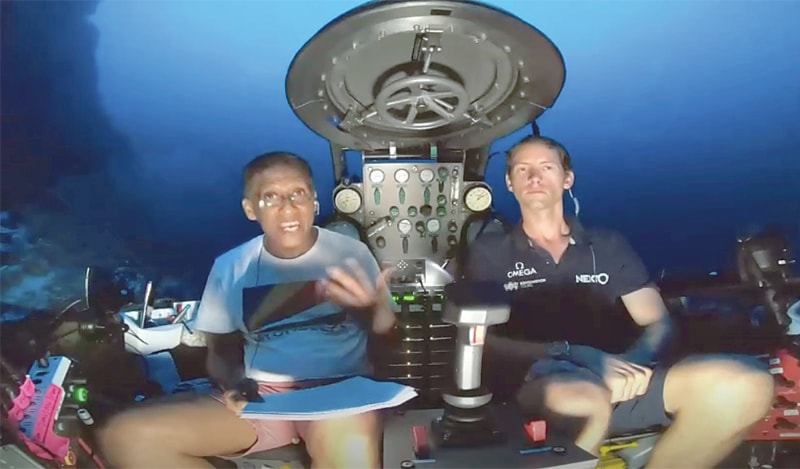 An image taken from video shows Seychelles President Danny Faure (left) speaking from inside a submersible from the vessel Ocean Zephyr off the coast of Desroches, in the outer islands of Seychelles, on Sunday.—AP