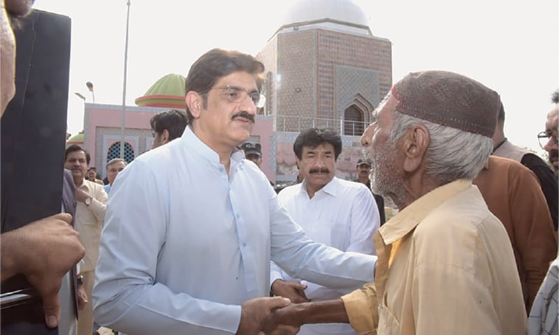 CM Syed Murad Ali Shah receives guests at the programme held on the 12th death anniversary of his father, Syed Abdullah Shah, in Wahur village on Sunday. —Dawn