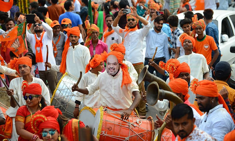 In this picture taken on April 14, 2019, Indian drummers perform before a road show of Bhartiya Janta Party (BJP) President Amit Shah (unseen) at Kalol town, some 30 km from Ahmedabad. — AFP