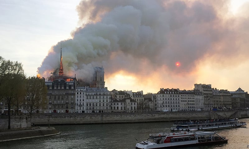 Smoke billows from the Notre Dame Cathedral after a fire broke out, in Paris. ─ Reuters