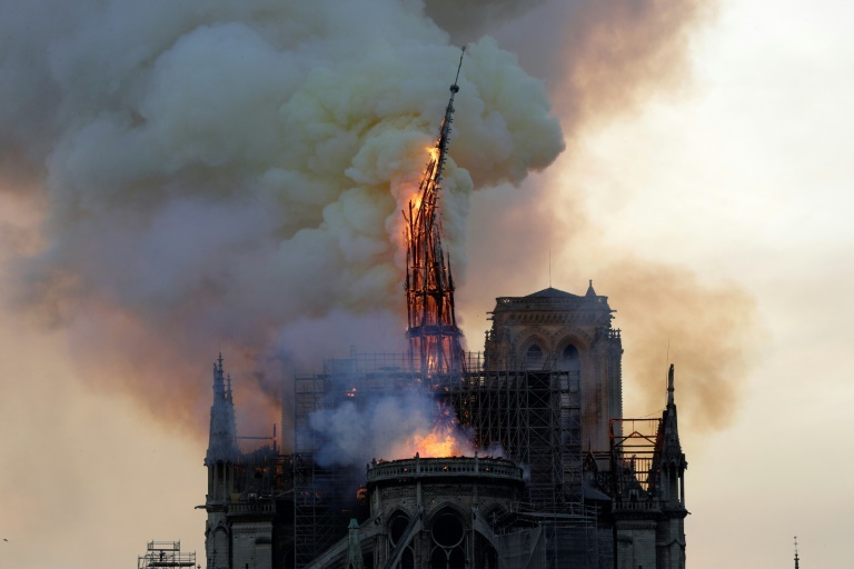 Fire struck Notre-Dame on Monday afternoon and destroyed the steeple within hours. — AFP
