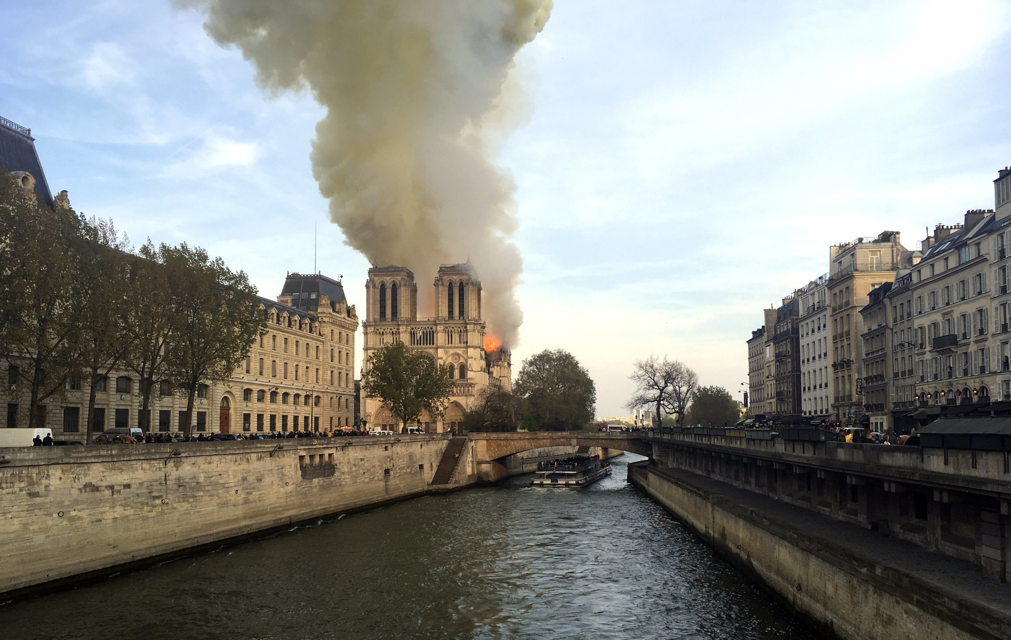 Massive plumes of yellow brown smoke filled the air above Notre-Dame Cathedral. — AP