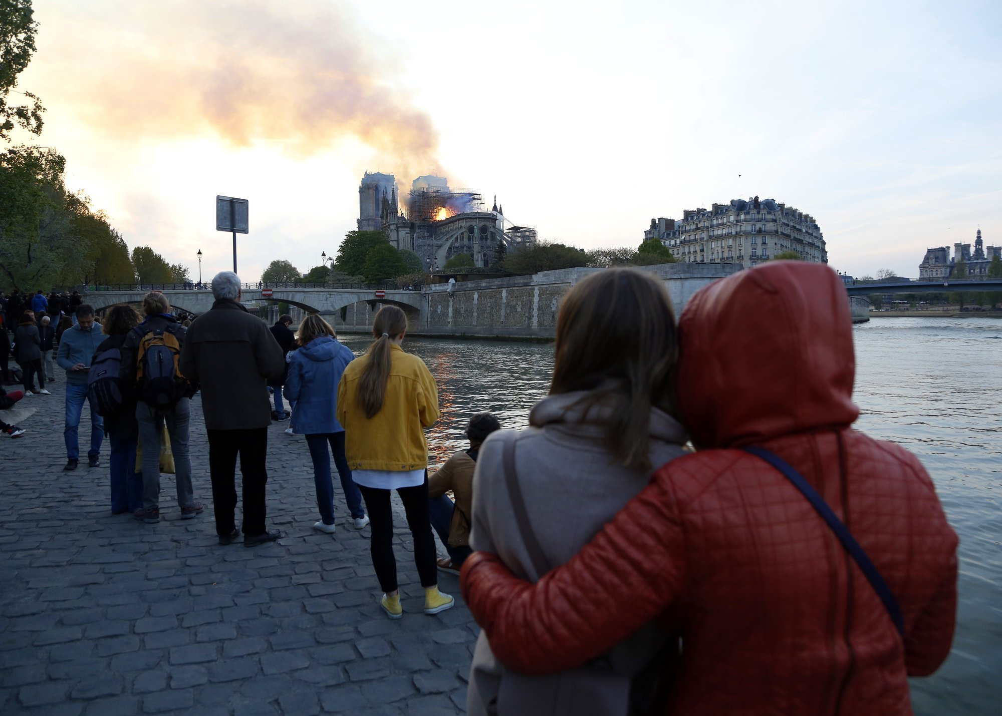 Notre-Dame cathedral is seen burning in Paris as tourists and Parisians look on aghast from the streets below. — AP