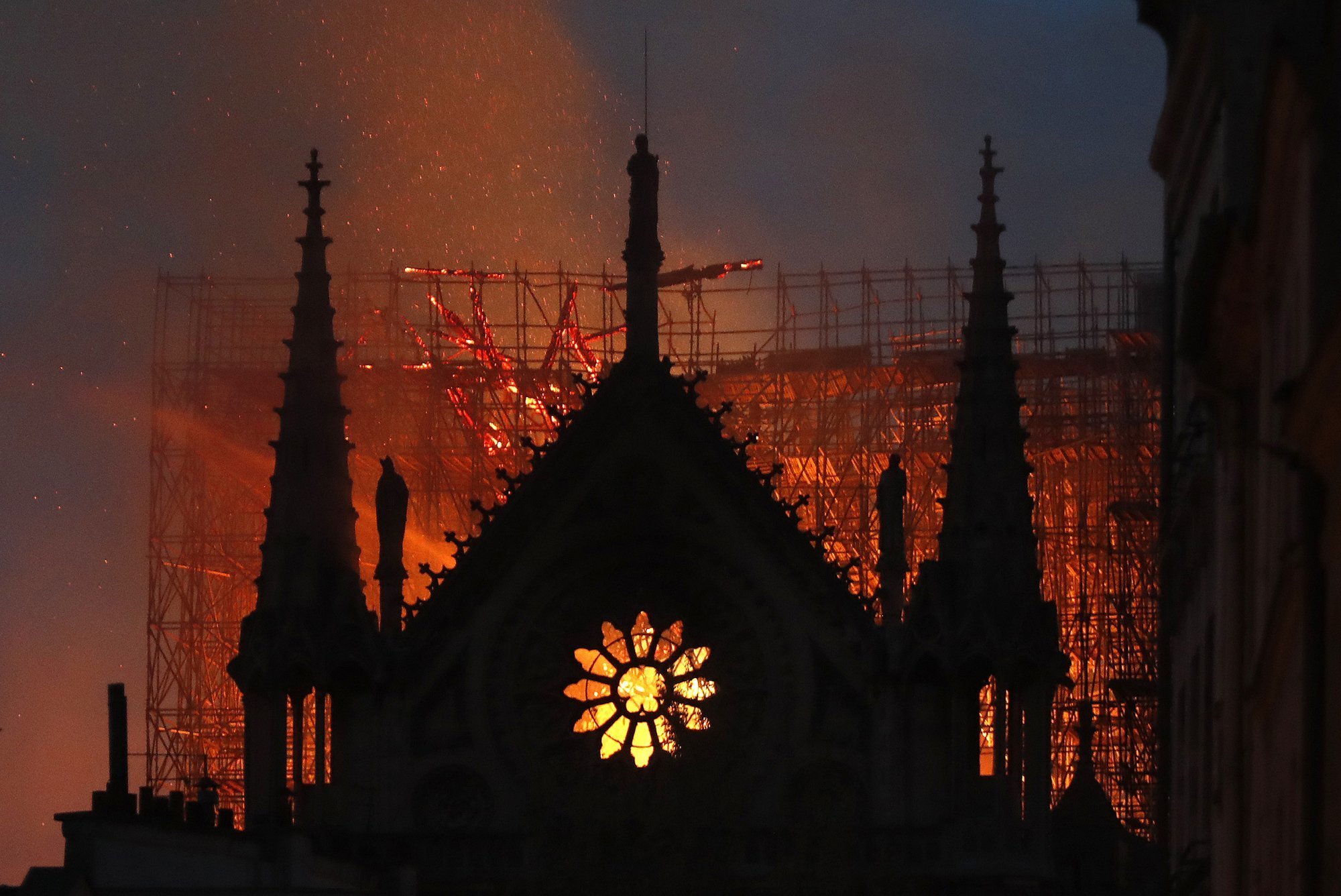 Flames and smoke rise from Notre-Dame cathedral as it burns in Paris on Monday. — AP