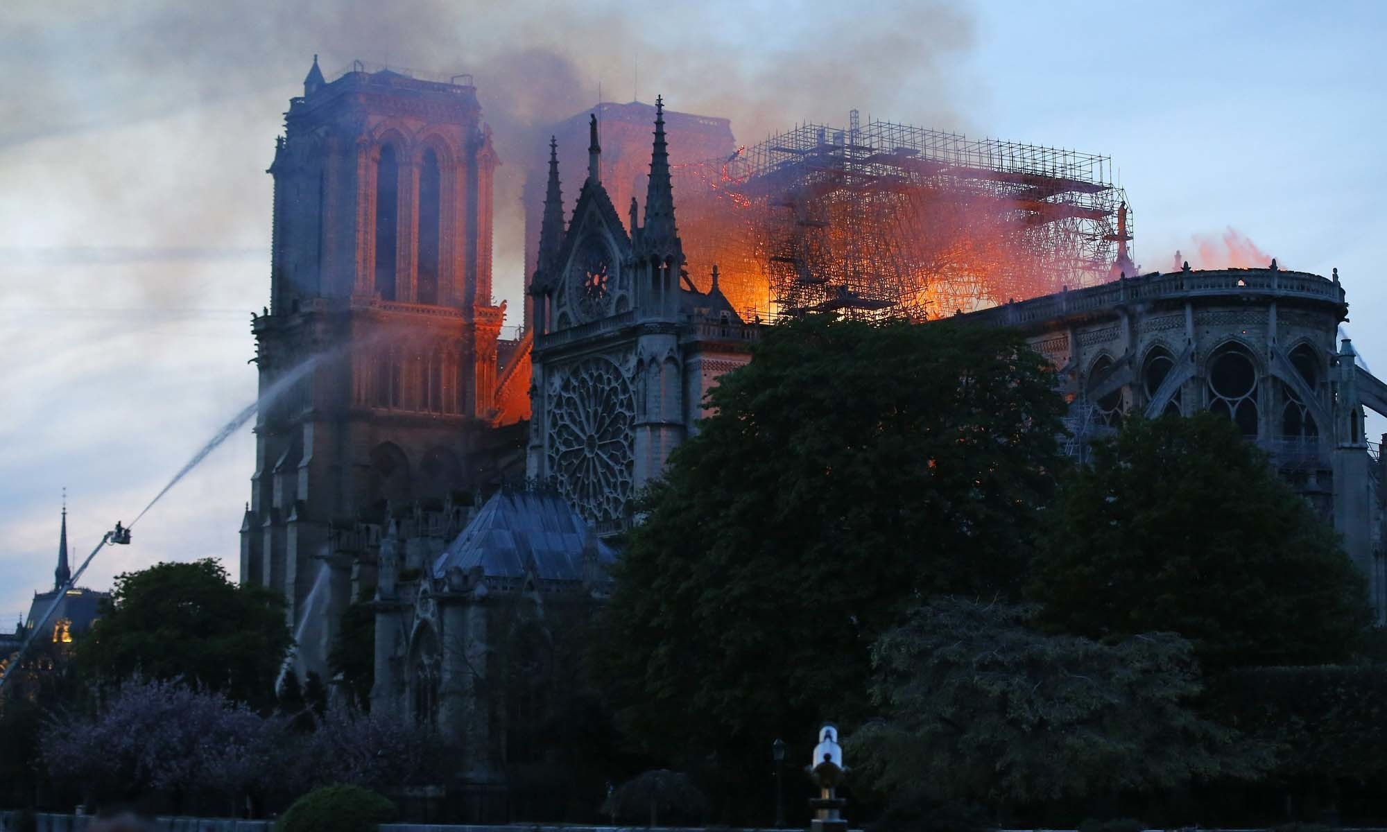 Notre-Dame fire under control after 9 hours, Macron vows 'cathedral will be reborn'