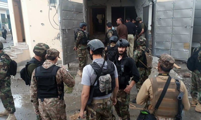Security personnel are seen at the site of the operation. — Arif Hayat