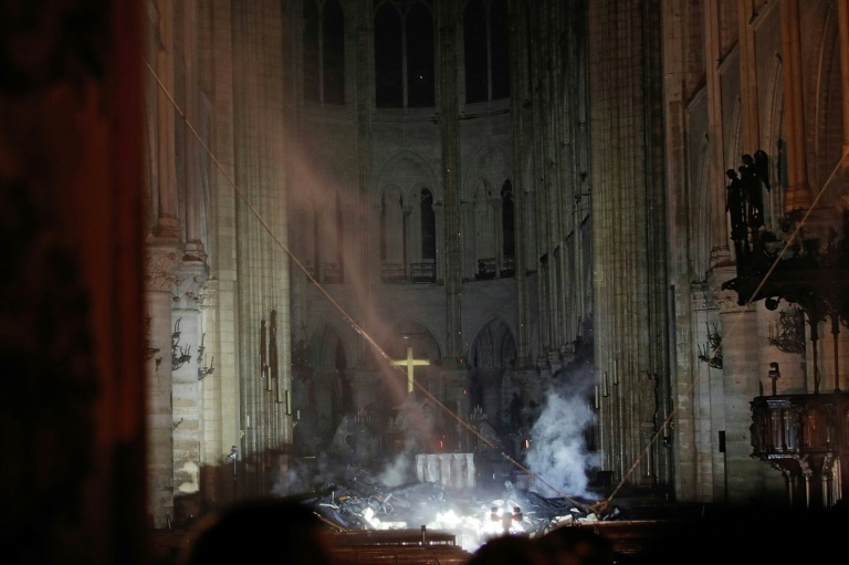 Most of the roof has been destroyed but the walls, bell towers and circular stained-glass windows remain in tact. ─ AFP